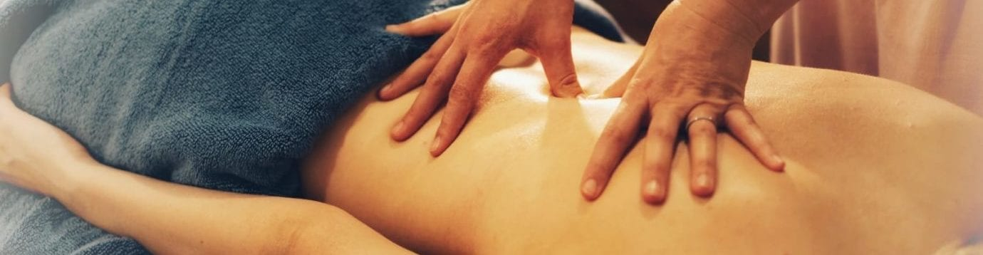photo of manual therapy on a patients back
