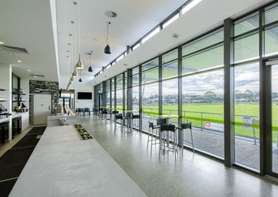 inside of sporting complex building with suspended ceilings